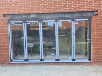 aluminium bi-fold doors during installation